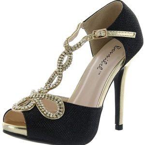 Black and gold tiara sandal heels.